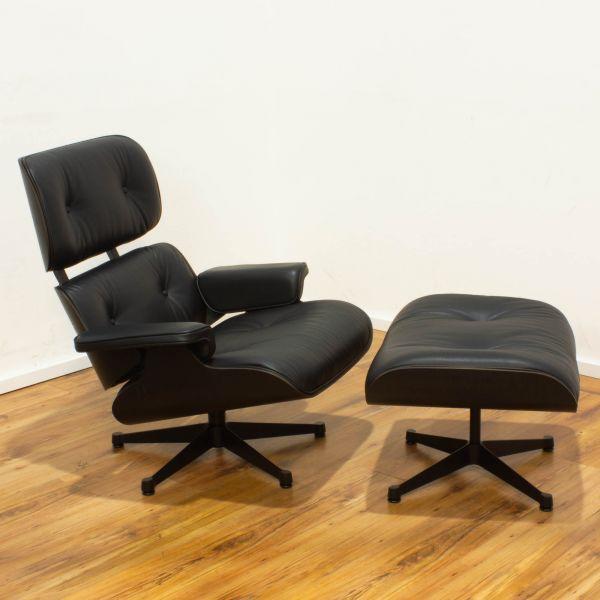 Vitra Lounge Chair - Leder schwarz - Schale Esche schwarz + Ottomane - Sonderangebot