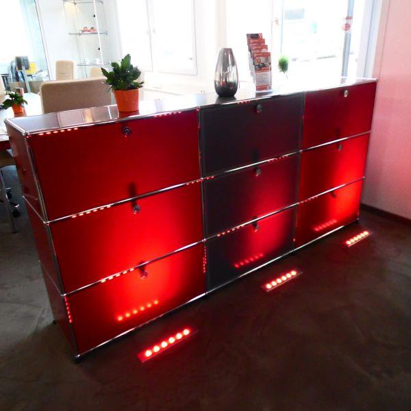 USM Haller Sideboard 9 Felder mit roten Klappen und grauen Lochtablar-Klappen